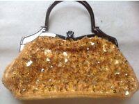 Smart small ladies handbag colour gold £2