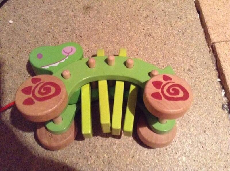 Pull along wooden Dino