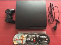 PS3 console with 1 controller and 3 games
