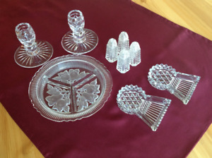 Crystal candle holders and butter dishes.  Glass condiment dish.