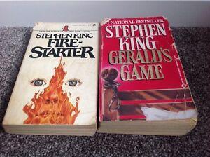 2 Stephen King paperback novels.