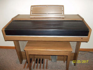 Yamaha organ with matching bench