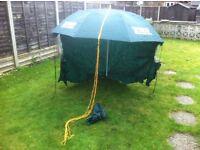Fishing umbrella and fold up stall £25.00