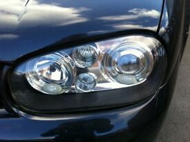 Set of genuine mk4 golf hella angel headlights