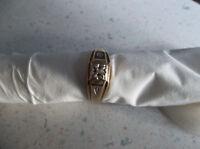 Men 10 karat gold ring with small diamond