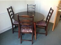 Dark wood drop leaf dining table and chairs