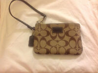Coach signature pattern wristlet