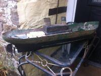 Old metal ship model for restoration.