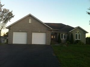 All Brick Bungalow with inground pool on a fenced 1.6 acre lot
