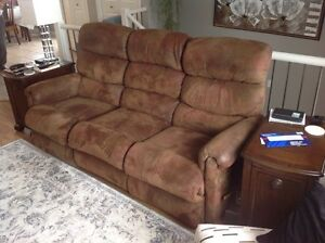 Like new reclining micro suede couch and loveseat