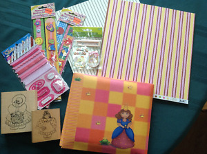 Scrapbooking album, paper, accessories and rubber stamps