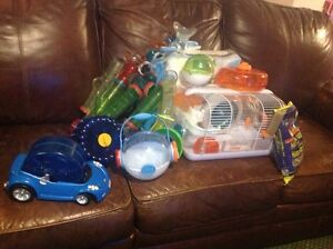 Hamster cage and tubing, toys...