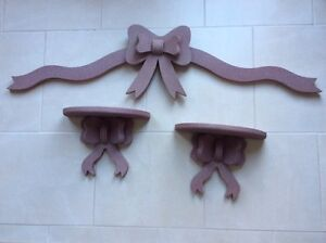 Three wooden bows