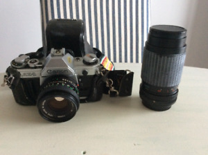Canon Ae-1 35mm film camera with 2 lenses and flash