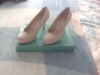 Nude platform shoes