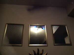 3 mirrors in picture frames