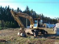 Cat 241 rubbertire excavator