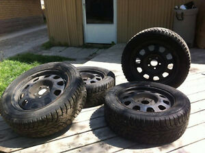STEAL OF A DEAL NEW WINTER TIRES WITH RIMS FULL SET