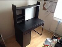 black IKEA desk with shelves and magnet board