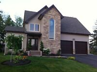 Executive Modern home in Dieppe w/ rental income