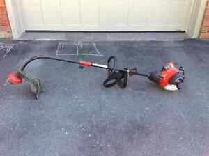 Troy-Bilt 4 Cycle 29cc Curved Gas Grass Trimmer, 17-in