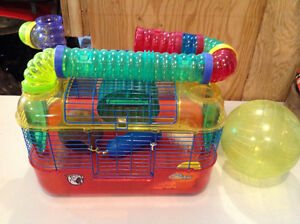 Hamster/rat cage with accessories.