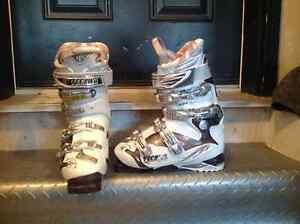 Women's and Men's ski boots and skis