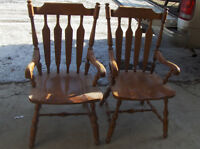 Two solid wood chairs $125.00 Great condition.