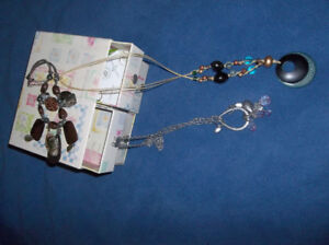 jewellery box with necklaces, bracelets and earrings .