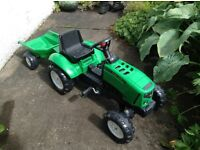 Falk green kids' ride-on tractor and trailer