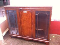 Old scuffed bookcase cabinet
