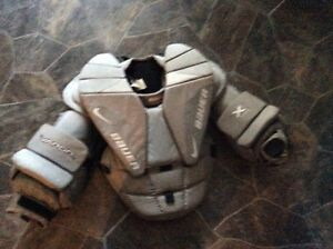 Goalie chest protector with stick