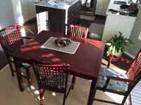 Dining room table (with 2 extensions) and 8 chairs