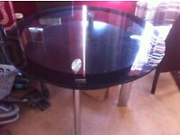 LARGE GLASS TABLE WITH 4 LEATHER CHAIR'S £55.00