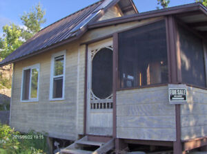 Waterfront Island Cottage front with bunkies in Callander Bay On