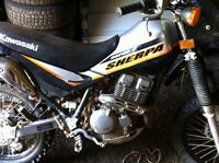 Looking to trade for a 2 stroke or a sled!!