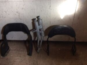 Backrest and muffler for snowmobiles want $50.00 each