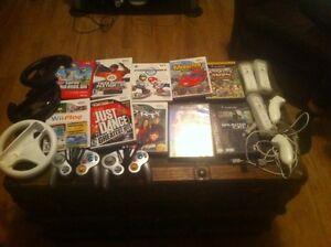 Wii avec plusieurs accesoires et jeux