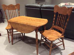 Wooden table and 2 matching chairs