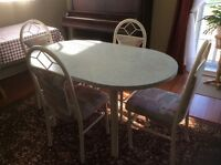 Kitchen table and four chairs with extra leaf