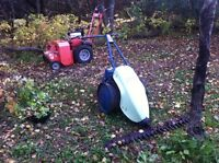Ditch clearing, trail making, tall grass cutting
