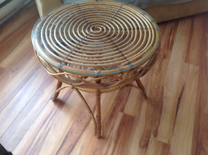 Round rattan and glass table