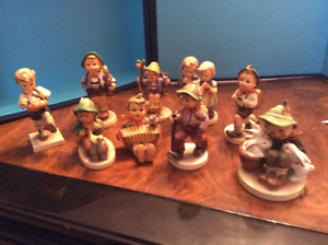 Set of 9 Antique Hummel figurines, excellent condition,with case