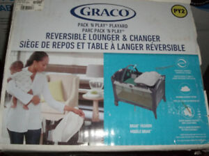 brand new in box.Graco Pack 'n Play with Reversible Lounger & C