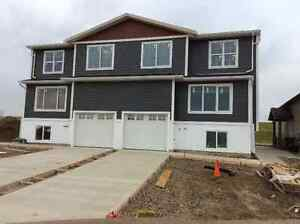 Brand New In Coalhurst with garage, granite, wet bar. Available.