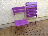 Purple folding metal chairs