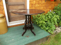 Antique solid wood oval table with steel roller wheels