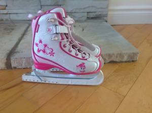 Patins à glace roses CCM junior 13
