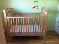 Crib with mattress, plastic safety cover & bedding