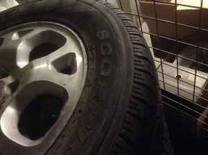 Two 235/65/17 winter tires with mags